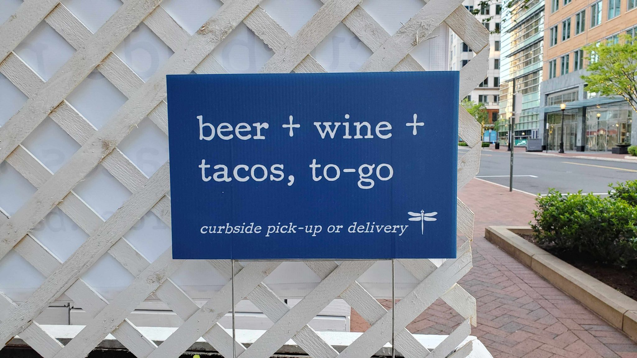 Restaurant signage directs customers on where to go for curbside pick up or delivery during COVID-19 when dining areas must remain closed.